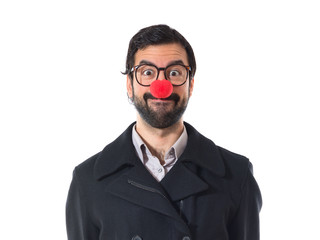 Handsome man with clown nose