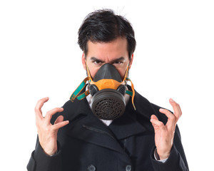 Handsome man in gas mask