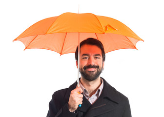 Man holding an umbrella over white background
