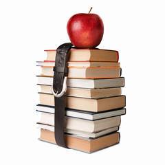 books pile with belt and apple