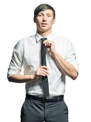 Portrait of businessman adjusting tie on neck