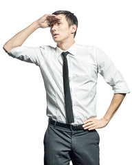Businessman holding his hand at forehead, looking forward