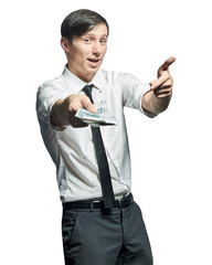 Businessman shows a wad of cash in hand.