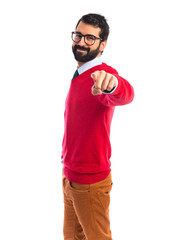Hipster man pointing to the front