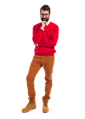 Hipster man thinking over white background