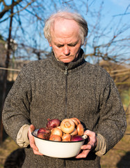 Farmer holding organic onion