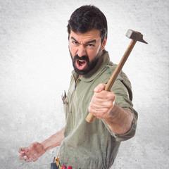 mechanic holding a hammer