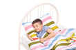 Cute little boy sleeping in a comfortable bed