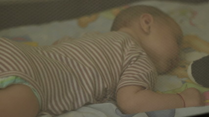 Baby Sleeping in Bed