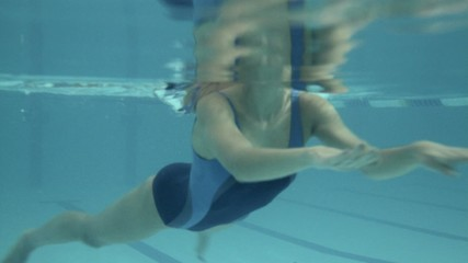 Female swimming in swimming pool in gym