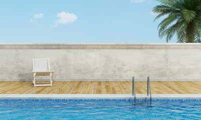 Swimming pool  with deckchair