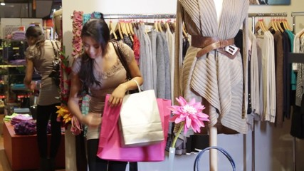 MS, Female walking around in clothes shop