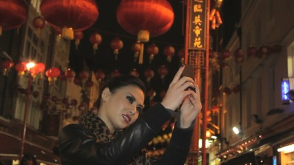 Female taking picture of herself in chinatown