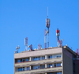 Antennas on the roof of a high apartment building