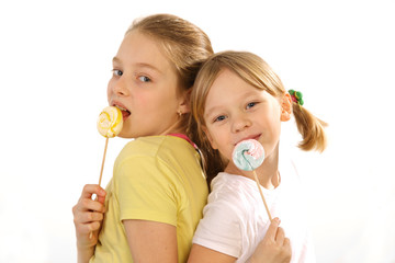 girls with lollipop   on a white background