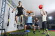 Group of people in action doing crossfit exercises