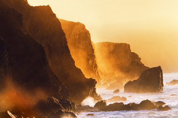 misty cliffs in the basque country coast