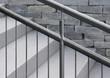 Leinwanddruck Bild - Edelstahlgeländer an Granittreppe mit unscharfem Hintergrund