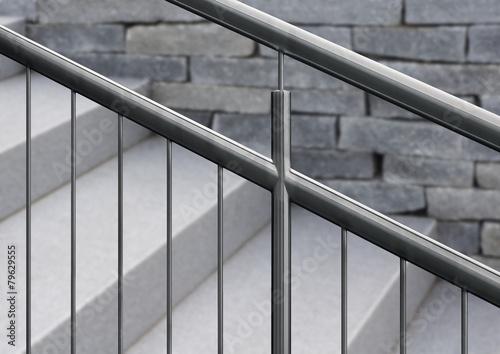 Leinwanddruck Bild Edelstahlgeländer an Granittreppe mit unscharfem Hintergrund