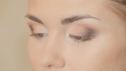 Professional makeup artist making eye makeup