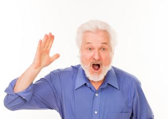 Elderly man with beard shouting