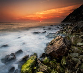 Rocky beach seascape at sunset