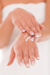 Beautiful woman massage herself with cream