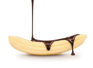 dark chocolate is poured on the ripe banana on a white backgroun