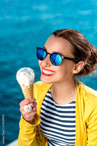 Leinwanddruck Bild Woman with ice cream