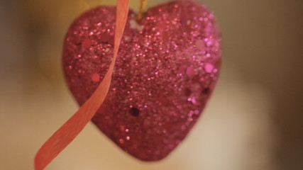 Shiny red heart in sequins.