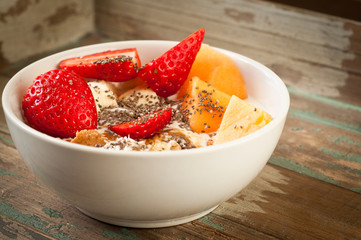 Healthy breakfast of muesli strawberries and melon.