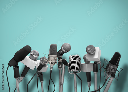 Press conference with standing microphones. - 79632960