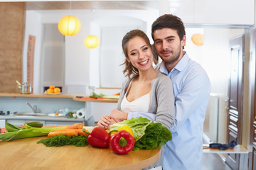 Young Сouple Сooking in The Kitchen. Healthy food