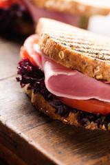 Sandwich with ham salad tomato on wood