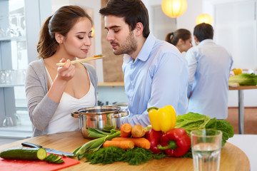 Young Сouple Сooking in Еhe Kitchen. Healthy food