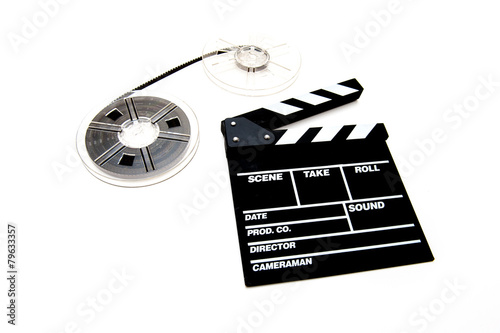 Vintage 8mm movie reels and clapper board white background - 79633357