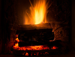 Burning fireplace with firewood