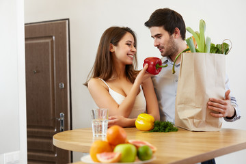 Young Couple with Grossery Bag full of Vegetables. Healthy Lifes