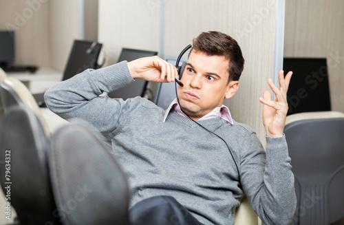 Leinwanddruck Bild Angry Customer Service Representative Gesturing While Using Head