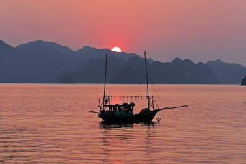 fish boat at Late afternoon in Halong Bay,Vietnam