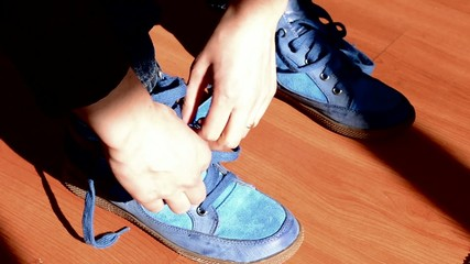 Girl Tying Shoelaces on Sneakers