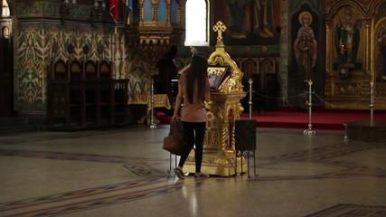 Girl Worshiping in Orthodox Church