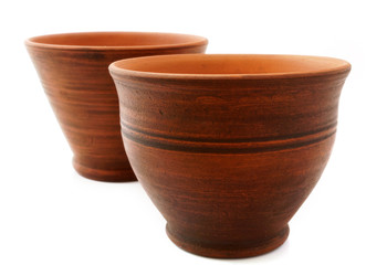 traditional clay mugs on white background.