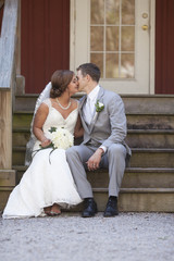 bride and groom seated on steps