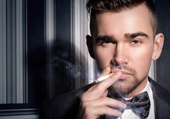 Handsome man with a cigarette