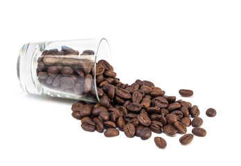 coffee beans pour out from glass shot