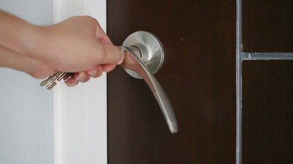 Unlocking door with key by hand