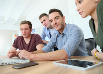 Group of young people in business training