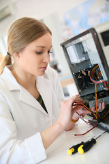 Student girl in technology fixug computer hard drive