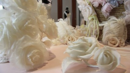 tracking shot of wedding and bridal accessories on a table